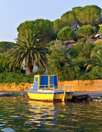 emborio: yellow wooden fishing boats on row corfu greece Stock Photo