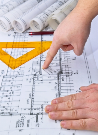 Architect drawing rolls and plans blueprints project photo