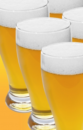 glass of beer over orange background Stock Photo - 17988752