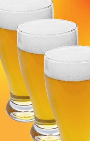 glass of beer over orange background photo