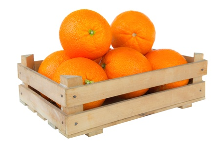 Fresh and ripe orange fruits in a wooden crate isolated on white background photo