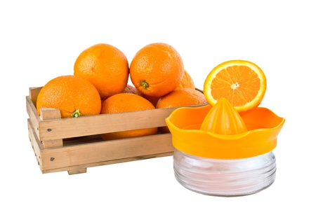 navel orange: orange fruits in a wooden crate isolated on white background