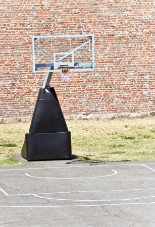 Basketball hoop and an empty outdoor court photo