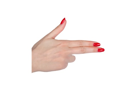 Female manicured hand pretending to shoot isolated on white background photo