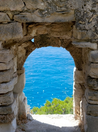 threw: View cliff and sea threw a old stone window Stock Photo