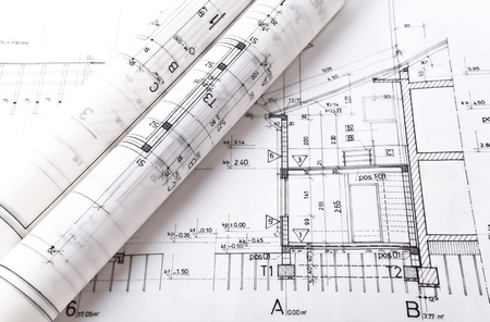 Architect rolls and plans project blueprint photo