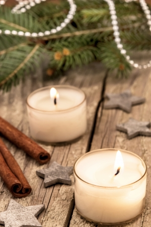 christmas candles over a old wood background photo