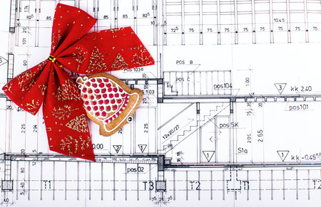 architect design blueprints and project drawings on table christmas background photo