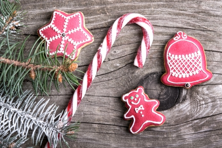 candy cane: Christmas cookies lollipop and gingerbread with festive decoration on wood background