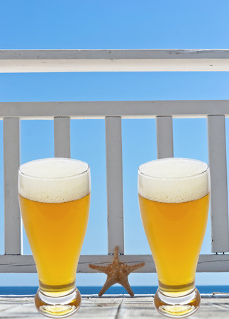 beer glass on terrace with star fish photo