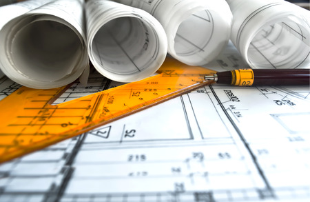 construction project: Architect rolls and plans project