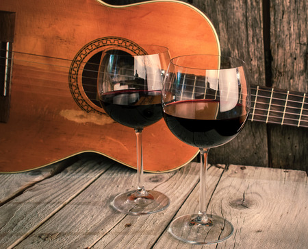 guitar and Wine on a wooden table romantic dinner background 스톡 콘텐츠
