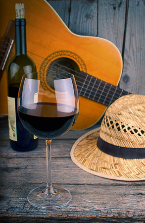 guitar and Wine on a wooden table photo