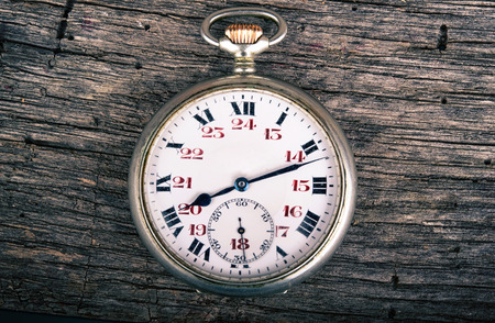 exactness: vintage pocked watch on old wood