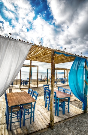 Greek tavern on beach photo
