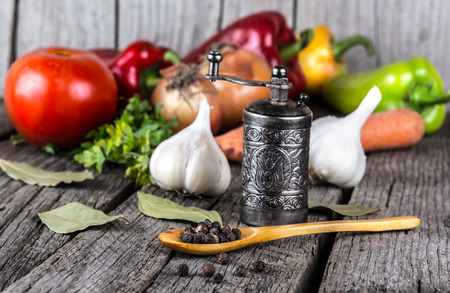 cook: organic food background Vegetables pepper mill