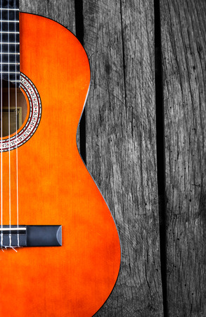 spanish Guitar on wood background photo