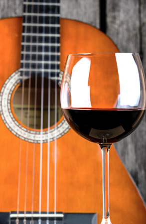 Wine and Guitar on a wooden table vintage retro photo photo