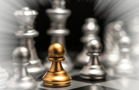 Stand out of a crowd  individuality concept Odd Chess Piece Stock Photo