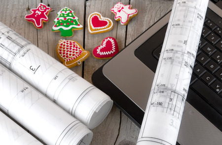 architect blueprints project and christmas gingerbread Stock Photo