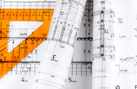 structural engineers: Architecture rolls architectural plans project architect blueprints Stock Photo