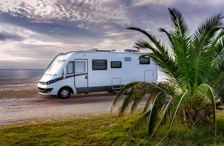 Camper van parked on a beach Stock Photo