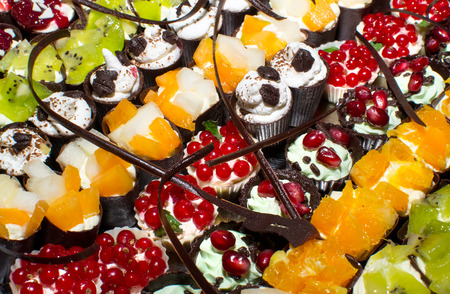 gastronomy: delicious miniature cakes catering sweets in buffet Stock Photo