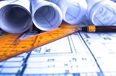 Architecture rolls architectural plans project architect blueprints real estate concept Foto de archivo