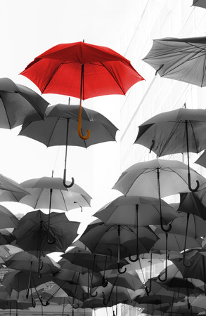 umbrella standing out from the crowd unique concept Stock Photo