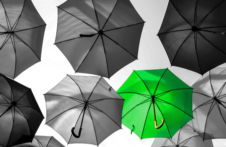 unique: umbrella standing out from the crowd unique concept Stock Photo