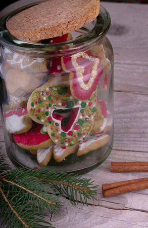 christmas gingerbread cookie on grungy wooden background
