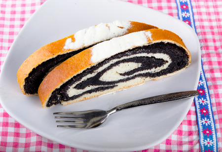 strudel: poppy seed strudel on kitchen table Stock Photo