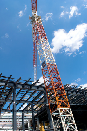 construction crane and the building against the blue sky
