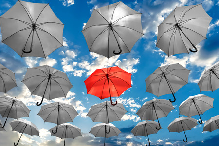 umbrella standing out from the crowd unique concept 스톡 콘텐츠