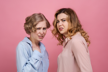 two young stylish girls are upset and shocked by the disgusting incident. On their faces an expression of extreme disgust and confusion. The spectacle is not for the faint of heart.