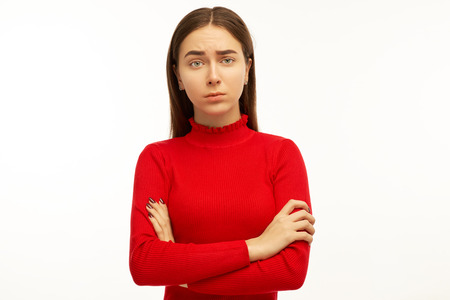 Handsome young student woman has serious look, listens interlocutor very attentively. Beautiful female puzzled looking at you and asks, Friend, you really did it? That cant be true.
