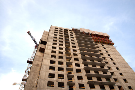 Construction of residential buildings of new neighborhoods. the process of building a multi-storey residential building. Stock Photo