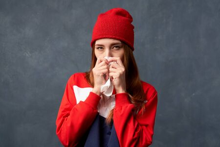 Girl sick, suffers runny nose, snot, feels unwell Stock fotó