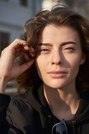 Feminine young businesswoman has mole above lip
