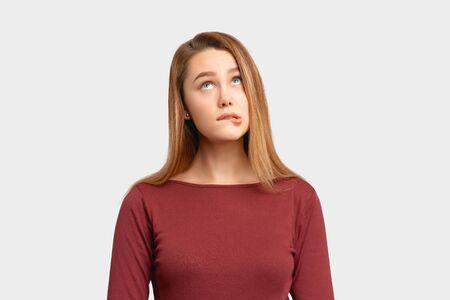 Portrait girl confused frightened look bite lip