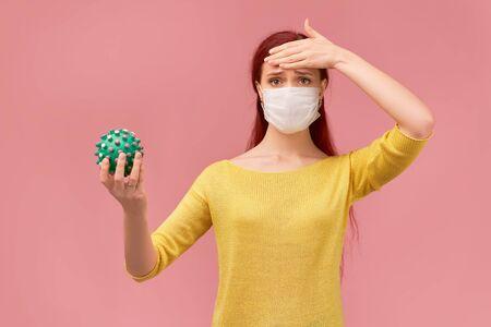 a Woman measures temperature on forehead, symptoms Standard-Bild