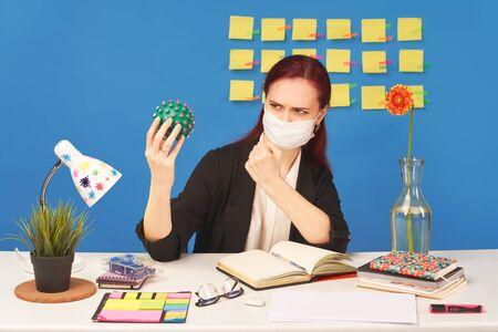 Woman menacingly shows fist virus, resists disease Standard-Bild