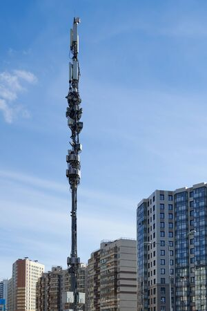 Cell tower with monitoring and control devices and antennas, transmitters and repeaters for mobile communications and the Internet