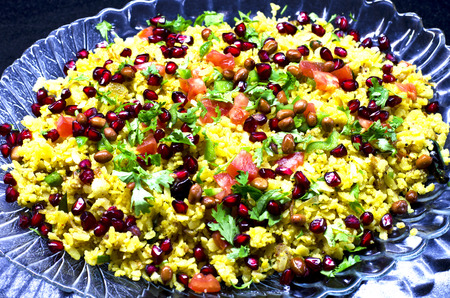 flattened: Poha, a popular Indian vegetarian dish prepared with flattened rice.