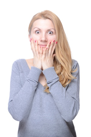 Beautiful young natural looking woman acting surprised photo