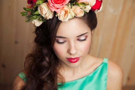 Young girl with flower crown in mint dress