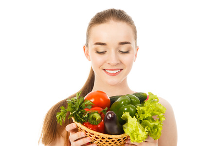 beautiful woman with vegetables isolated photo