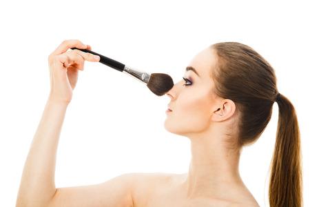 beautiful woman applying cosmetic with brush Stock Photo