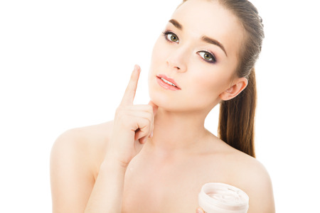 face cream: beautiful woman with face cream Stock Photo