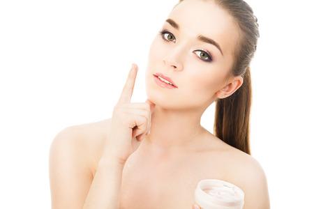 cara de alegria: hermosa mujer con crema para la cara